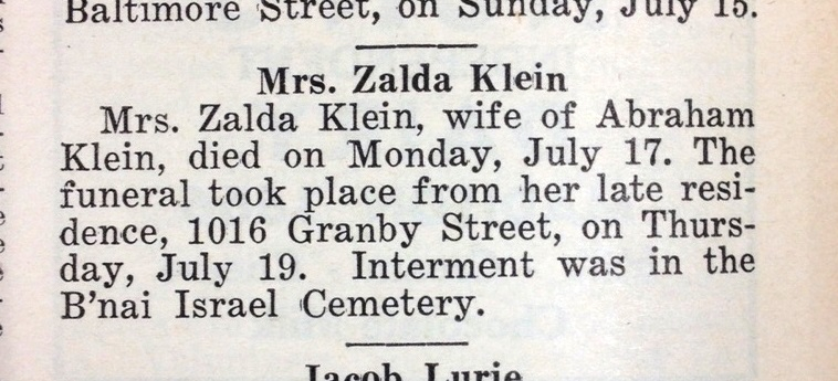 blurry obituary from newspaper